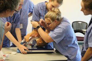 Participant learning how to use an esophageal scope